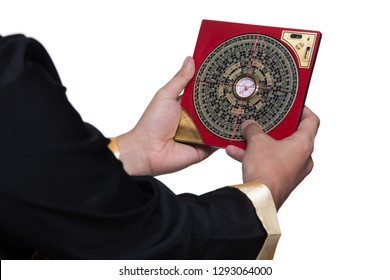 Feng Shui Master show FengShui Compass and turn direction to Force Energy, Chinese Texts on Compass mean translate as North South West East Luck Prosperity on Wind Water elements Flow, isolated