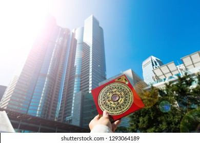 Feng Shui Master show FengShui Compass and turn direction to Force Energy, Many Chinese Texts on Compass translate as North South West East Luck Prosperity on Wind Water elements Flow Design Building