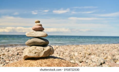 Feng Shui and Zen concept with stack of stones on the beach by the Baltic Sea