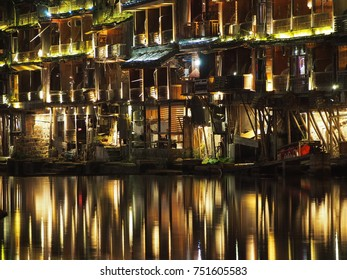 Fenghuang, China - 18 October, 2016: The lights of Fenghuang old town at night reflected in the river.