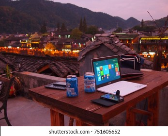 Fenghuang, China - 18 October, 2016: Remote working on a rooftop in the old town of Fenghuang, Hunan.