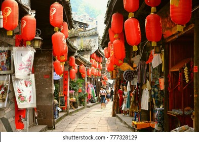 Fenghuang, China - May 15, 2017: The decoration of red umbrella on the streets of Fenghuang Ancient Town (Phoenix ancient town).