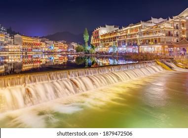 Fenghuang, China - May 29, 2018: Ancient town Fenghuang at sunset in Hunan.
