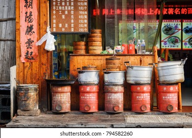 Fenghuang, China - September 23, 2017: Scenic view of cooking pots and Dim Sum baskets outside traditional Chinese restaurant in Phoenix Ancient Town (Fenghuang County).