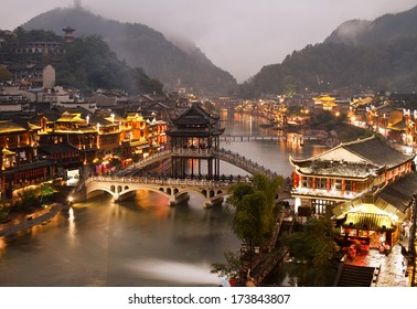 Fenghuang (Phoenix) ancient town at night, Hunan province, China.