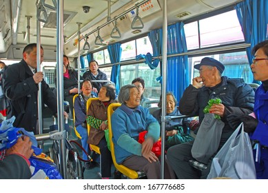 FENGJING, SHANGHAI, CHINA - MARCH 17: local and tourists on a city bus. The ancient village is a Shanghai tourist attraction with 100000 visitors per year. March 17, 2010, Fengjing, China.