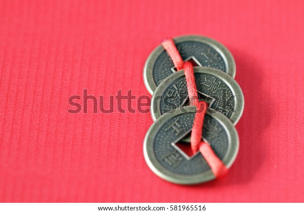 Fengshui chinese coins on the red background
