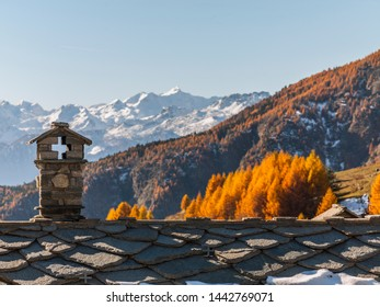 Fenilliaz, Aosta Valley, Italy - November 15, 2012: Flagstone roof with traditional chimney stack in a mountain village.