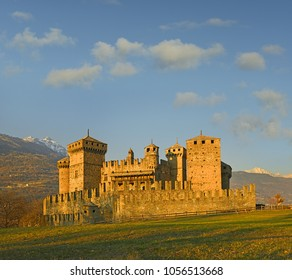 Fenis Castle in Aosta Valley at sunset. Fenis Castle is one of the castles guarding the Aosta Valley. Aosta Valley in Italy is full of medieval castles.