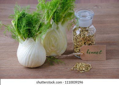 fennel bulb and seeds in a glass jar with a label on wooden background