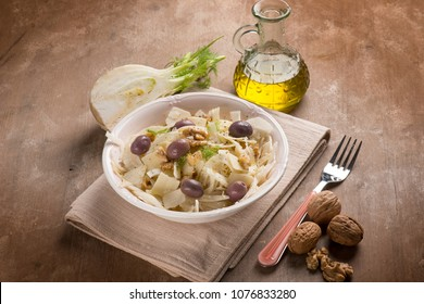fennel salad with parmesan cheese flakes black olives and nuts