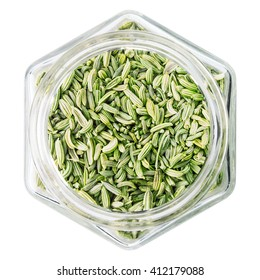 fennel seeds in glass bottle, isolated on white background