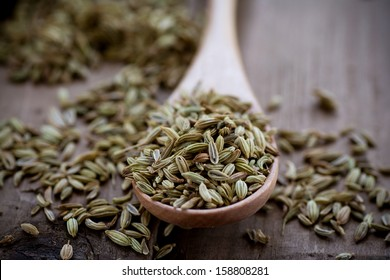 Fennel seeds on wooden spoon