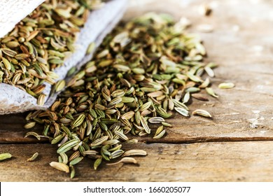 Fennel seeds on wooden table