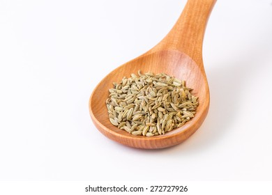 Fennel seeds in a wooden spoon - view from top