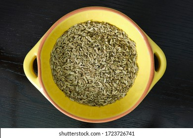 Fennel sees in a rustic yellow dish