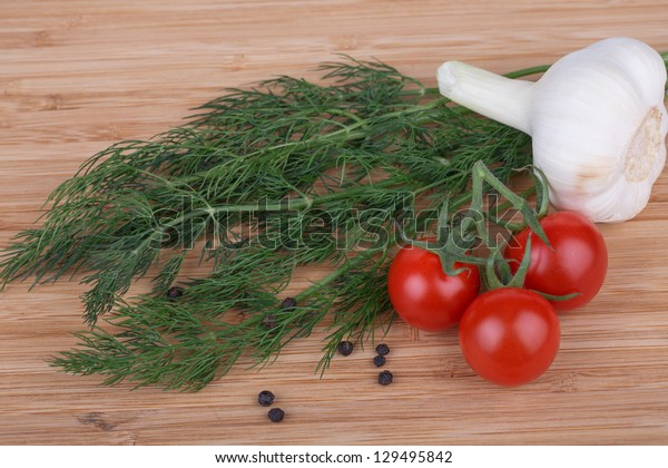 fennel, tomatoes, hot peppers and garlic on a wooden background
