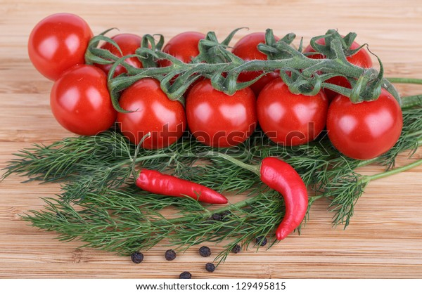 fennel, tomatoes, hot peppers on a wooden background