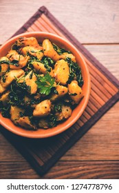 Fenugreek potato sabzi or Aloo Methi masala is healthy Indian Cuisine. served in a bowl or karahi. selective focus