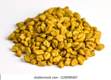 Fenugreek seeds on a white background