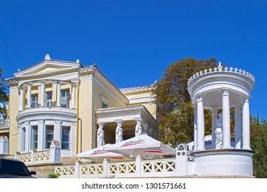 Feodosia, Russia - 6 Sep 2016: Old Milos Villa (1911) in antique style with statue of Aphrodite of Milos (Venus de Milo). Symbol of Feodosia. Words: 'Crimean Riviera'
