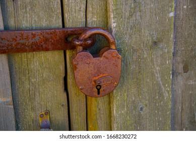 FERAPONTOVO, VOLOGDA OBLAST, RUSSIA - MAY 1, 2015: hinged iron lock on the door