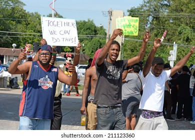 FERGUSON, MO/USA  AUGUST 15, 2014: Demonstrator at the site of destroyed Quick Trip react after Police Chief Thomas Jackson release of the name of the officer that shot Michael Brown.