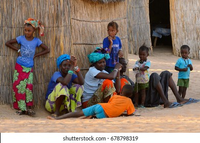 FERLO DESERT, SENEGAL - APR 25, 2017: Unidentified Fulani people locate near the shack. Fulanis (Peul) are the largest tribe in West African savannahs