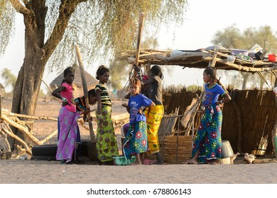 FERLO DESERT, SENEGAL - APR 25, 2017: Unidentified Fulani women stand on the street in the village. Fulanis (Peul) are the largest tribe in West African savannahs