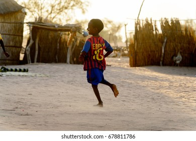 FERLO DESERT, SENEGAL - APR 25, 2017: Unidentified Fulani little boy plays on the street in the village. Fulanis (Peul) are the largest tribe in West African savannahs