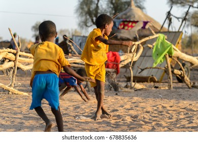 FERLO DESERT, SENEGAL - APR 25, 2017: Unidentified Fulani little children play on the street. Fulanis (Peul) are the largest tribe in West African savannahs