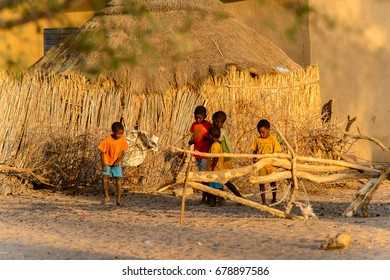 FERLO DESERT, SENEGAL - APR 25, 2017: Unidentified Fulani little children play on the yard in the village. Fulanis (Peul) are the largest tribe in West African savannahs