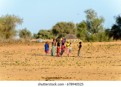 FERLO DESERT, SENEGAL - APR 25, 2017: Unidentified Fulani children play in the street. Fulanis (Peul) are the largest tribe in West African savannahs
