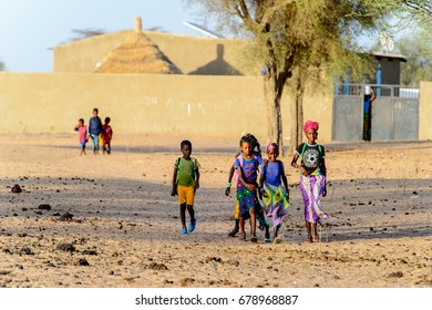 FERLO DESERT, SENEGAL - APR 25, 2017: Unidentified Fulani people walk along the street. Fulanis (Peul) are the largest tribe in West African savannahs