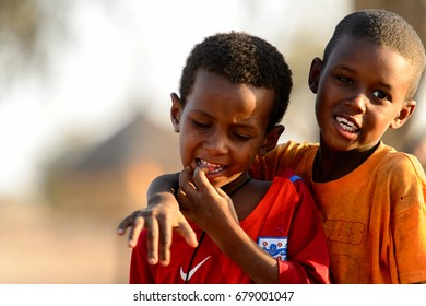 FERLO DESERT, SENEGAL - APR 25, 2017: Unidentified Fulani little boys play on the street. Fulanis (Peul) are the largest tribe in West African savannahs