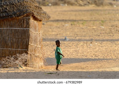 FERLO DESERT, SENEGAL - APR 25, 2017: Unidentified Fulani little boy walks along the street. Fulanis (Peul) are the largest tribe in West African savannahs