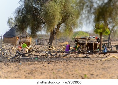 FERLO DESERT, SENEGAL - APR 25, 2017: Unidentified Fulani women stand near the shack in the village . Fulanis (Peul) are the largest tribe in West African savannahs