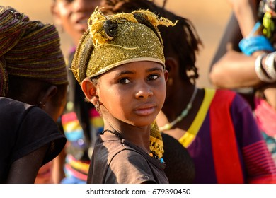 FERLO DESERT, SENEGAL - APR 25, 2017: Unidentified Fulani little girl in headscarf looks ahead. Fulanis (Peul) are the largest tribe in West African savannahs