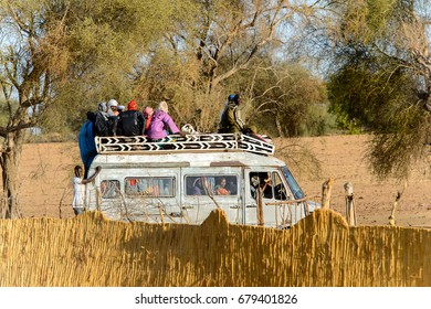 FERLO DESERT, SENEGAL - APR 25, 2017: Unidentified Fulani people ride on the roof f the car. Fulanis (Peul) are the largest tribe in West African savannahs