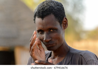 FERLO DESERT, SENEGAL - APR 25, 2017: Unidentified Fulani skinny man stands in the village. Fulanis (Peul) are the largest tribe in West African savannahs