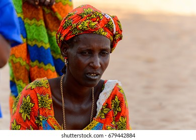 FERLO DESERT, SENEGAL - APR 25, 2017: Unidentified Fulani woman in colored traditional clothes looks ahead. Fulanis (Peul) are the largest tribe in West African savannahs