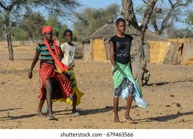 FERLO DESERT, SENEGAL - APR 25, 2017: Unidentified Fulani people go back to the village. Fulanis (Peul) are the largest tribe in West African savannahs