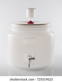 Fermentation bucket for home beer brewing with airlock.