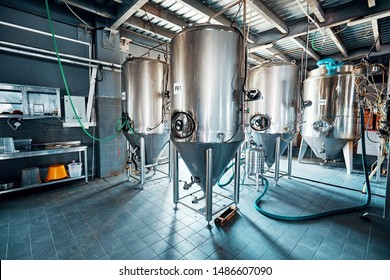 Fermentation mash vats or boiler tanks in a brewery factory. Brewery plant interior.