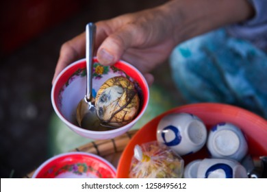 Fermented balut egg in a bowl. At Han Market, Da Nang.