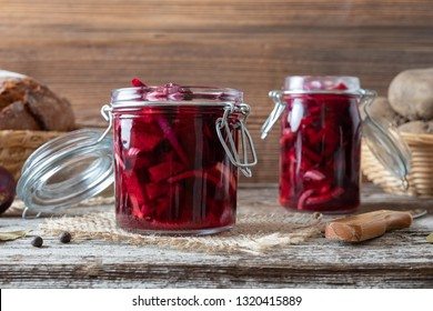 Fermented beet kvass in two glass jars