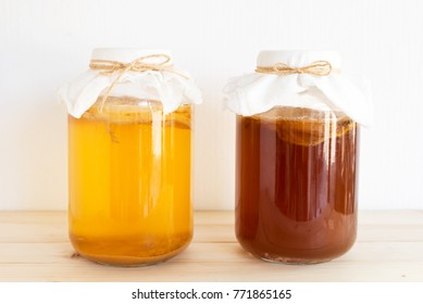 fermented drink, jun tea healthy natural probiotic in a glass jar.