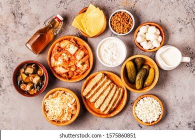 Fermented food, probiotics - kefir, kombucha, sauerkraut, pickles, miso soup, tempeh, natto, kimchi, yogurt, mozzarella and gouda cheeses, cottage cheese.