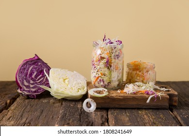 Fermented foods, Sauerkraut in a glass jar. Marinating cabbage on the table. The best natural probiotic.  homemade kraut., Copy space for text. green and red cabbage