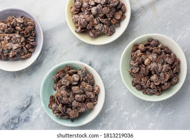 Fermented locust beans in small bowls